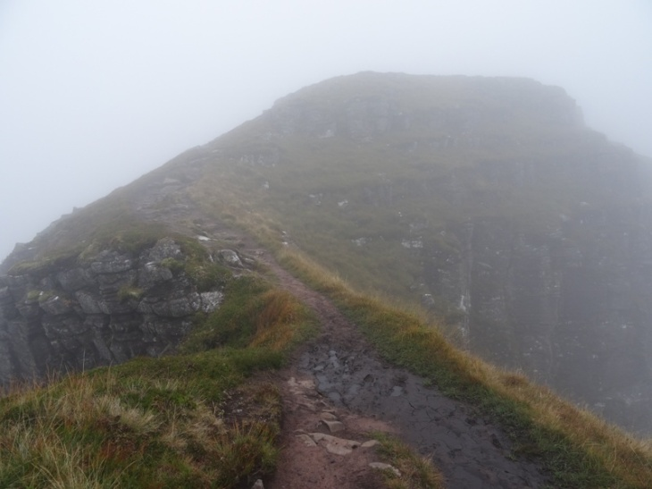 One of the very narrow (and also muddy and slippery) sections on the ridge going towards Suilven's summit.