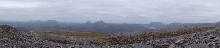 Views from the summit to the west - Suilven is the double peaked one, Canisp is to its right. Quinag is the large multipeaked ridge on the right.