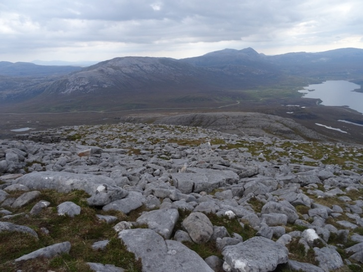 Boulder field and quartzite pavement down the expansive, wide flank of Spidean Conich (looking east).