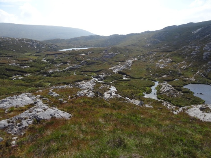 The beautiful saddle filled with lochs and streams (and bogs).