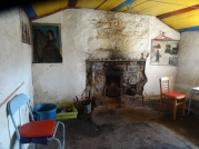 Bright colours and paintings ON the walls in Strathchailleach bothy.