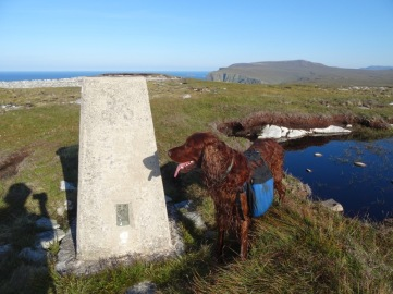 Posing dutifully next to the trig point on Dùnan Mòr (looking east towards Kearvaig).